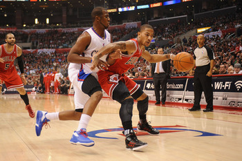 Hi-res-136282937-derrick-rose-of-the-chicago-bulls-dribbles-against_display_image