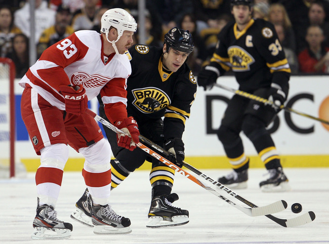 Hi-res-134097937-johan-franzen-of-the-detroit-red-wings-and-milan-lucic_crop_650