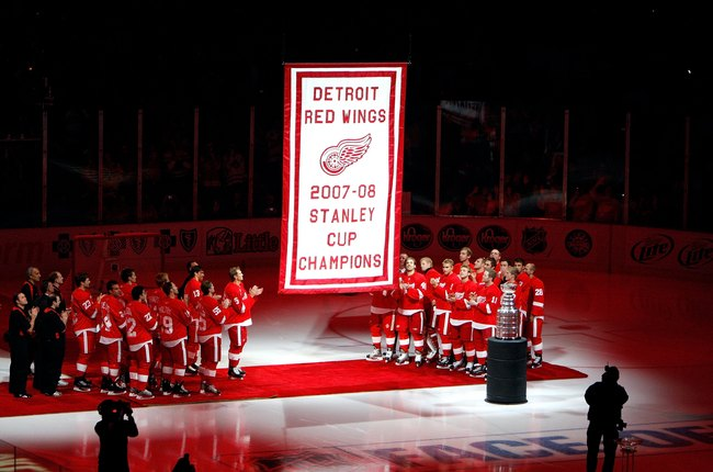 Hi-res-83293664-members-of-the-detroit-red-wings-look-on-as-their-2007_crop_650