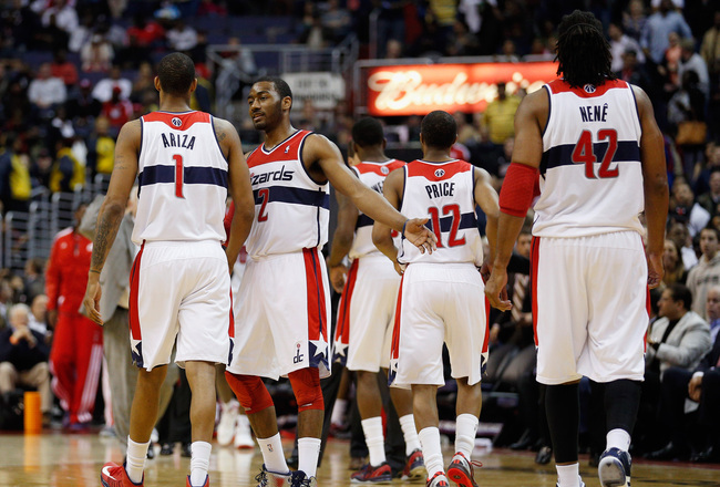 Hi-res-165297387-john-wall-of-the-washington-wizards-talks-with-teammate_crop_650x440