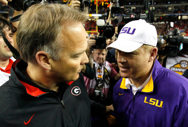Hi-res-134721748-head-coach-les-miles-of-the-lsu-tigers-converses-with_crop_650x440