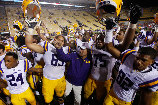 Hi-res-181502470-head-coach-les-miles-of-the-lsu-tigers-celebrates-with_crop_650