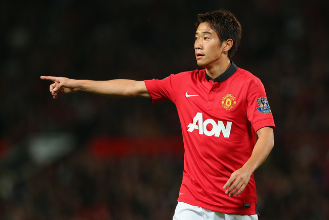 Hi-res-181801319-shinji-kagawa-of-manchester-united-gestures-during-the_crop_650