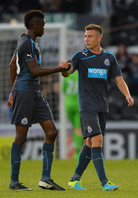 Sammy Ameobi (left) and Paul Dummett