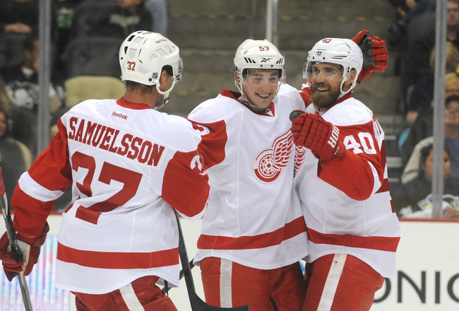 Hi-res-180801227-adam-almquist-of-the-detroit-red-wings-is-congratulated_crop_650x440