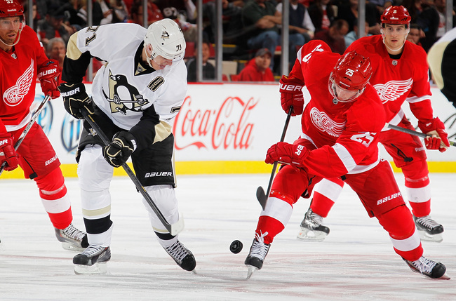 Hi-res-181819588-cory-emmerton-of-the-detroit-red-wings-battles-for-the_crop_650