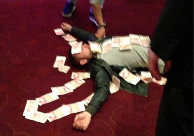 Bardsley-appeared-to-enjoy-his-winnings-a-touch-too-enthusiastically-though-and-was-pictured-lying-down-before-friends-covered-him-in-banknotes-football_crop_650