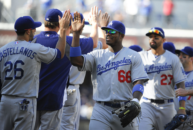 Hi-res-181594072-los-angeles-dodgers-players-high-five-after-beating-the_crop_650x440