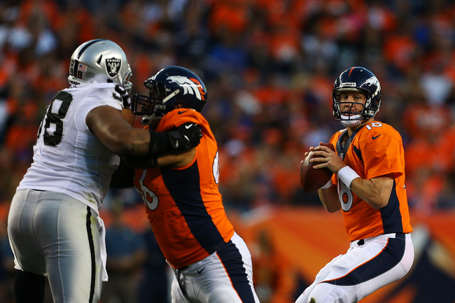 Hi-res-181701062-peyton-manning-of-the-denver-broncos-looks-to-pass_crop_650