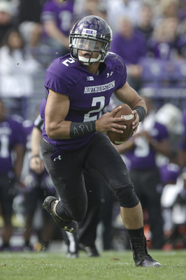 Hi-res-181797279-kain-colter-of-the-northwestern-wildcats-rushes-on-the_display_image
