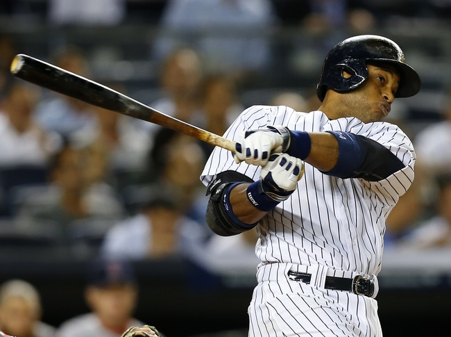 Hi-res-179613688-robinson-cano-of-the-new-york-yankees-hits-a-double-off_crop_650