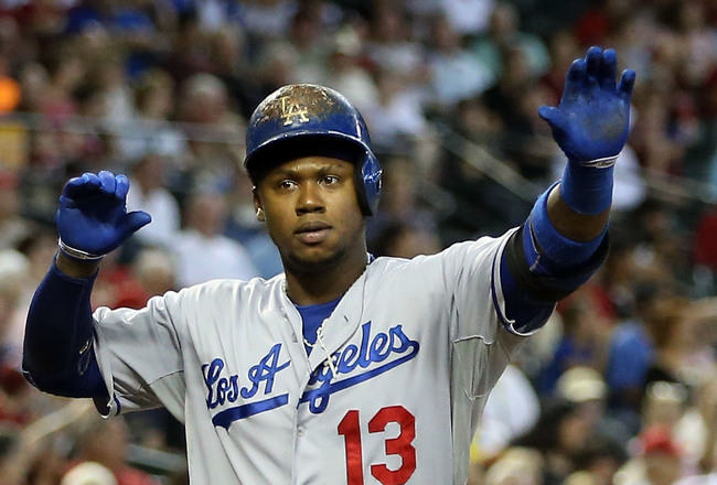 Hi-res-181176753-hanley-ramirez-of-the-los-angeles-dodgers-high-fives_crop_650x440