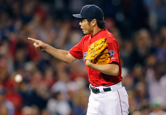 Hi-res-181395745-koji-uehara-of-the-boston-red-sox-reacts-after-the_crop_650