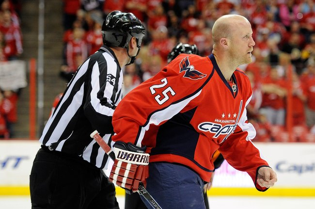 Hi-res-98483494-jason-chimera-of-the-washington-capitals-is-led-off-the_crop_650