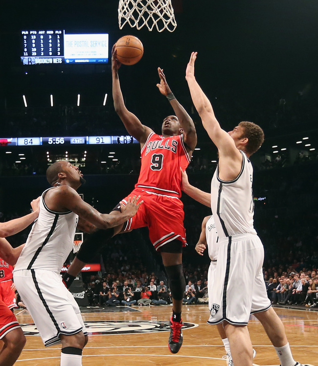 Hi-res-167772772-luol-deng-of-the-chicago-bulls-takes-the-shot-against_crop_650