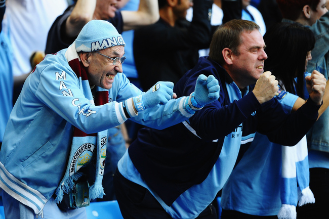 Hi-res-181548511-manchester-city-fans-celebrate-during-the-barclays_crop_650