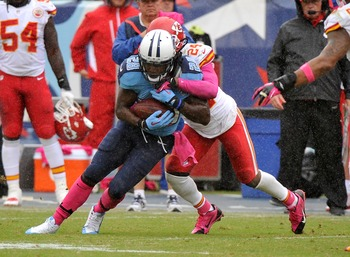 Hi-res-183457204-chris-johnson-of-the-tennessee-titans-is-tackled-by_display_image