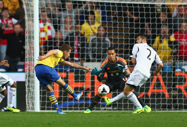 Hi-res-182117893-aaron-ramsey-of-arsenal-scores-his-sides-second-goal_crop_650x440