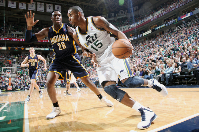 Hi-res-160140220-derrick-favors-of-the-utah-jazz-drives-against-ian_crop_650