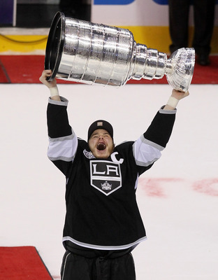 Hi-res-146298454-captain-dustin-brown-of-the-los-angeles-kings-holds-up_display_image