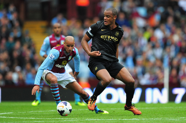 Hi-res-182104958-manchester-city-player-vincent-kompany-holds-off-villa_crop_650