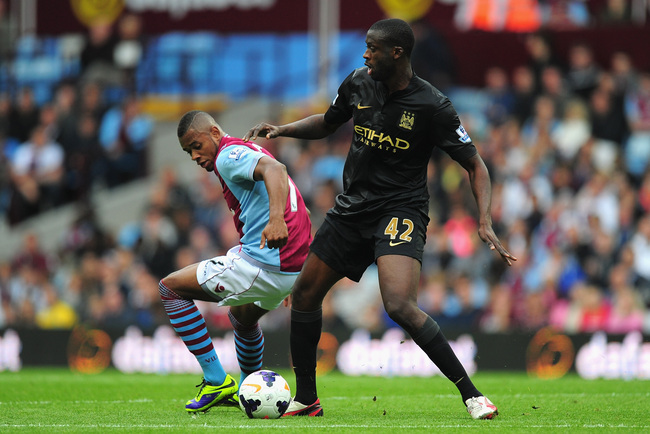 Hi-res-182104871-manchester-city-player-yaya-toure-holds-off-villa_crop_650