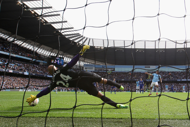 Hi-res-183153259-sergio-aguero-of-manchester-city-scores-from-a-penalty_crop_650