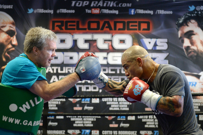Hi-res-180973599-miguel-cotto-spars-with-trainer-freddie-roach-in_crop_650