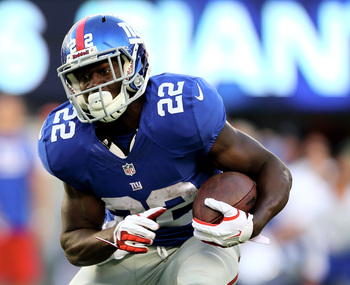 Hi-res-180651379-david-wilson-of-the-new-york-giants-carries-the-ball-in_display_image