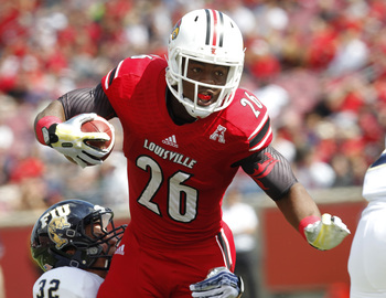 Hi-res-181466324-michael-dyer-of-the-louisville-cardinals-breaks-free_display_image