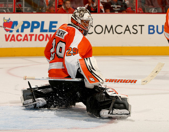 Hi-res-180884706-ray-emery-of-the-philadelphia-flyers-deflects-the-puck_display_image