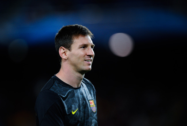 Hi-res-181667999-lionel-messi-of-fc-barcelona-looks-on-during-the-warm_crop_650x440