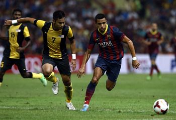 Hi-res-175933199-alexis-sanchez-of-barcelona-fc-is-pursuit-by-mohd-aidil_display_image
