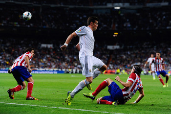 Hi-res-182172969-gareth-bale-of-real-madrid-cf-duels-for-the-ball-with_display_image