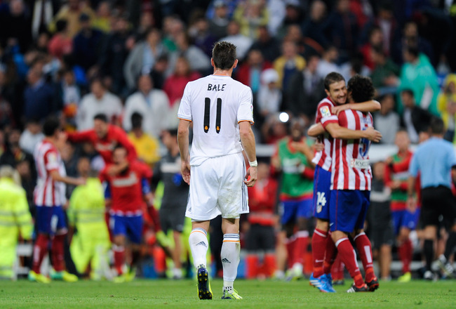 Hi-res-182189686-gareth-bale-of-real-madrid-leaves-the-pitch-as-atletico_crop_650x440
