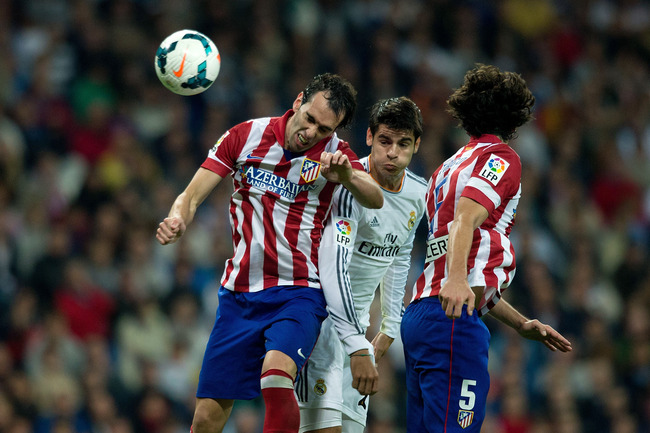 Hi-res-182220633-tiago-mendes-of-atletico-de-madrid-wins-the-header_crop_650