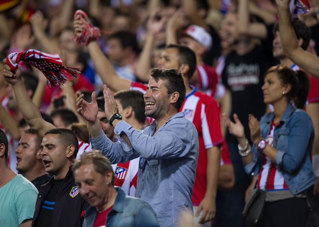 Hi-res-181755567-atletico-de-madrid-fans-cheer-their-side-during-the-la_crop_650
