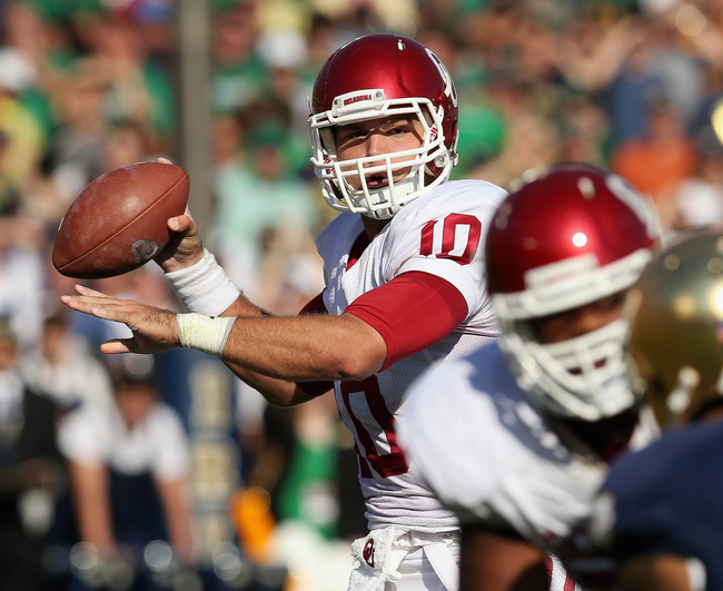 Hi-res-182172840-blake-bell-of-the-oklahoma-sooners-passes-against-the_crop_650