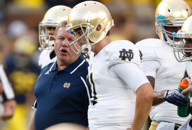 Hi-res-181935767-notre-dame-head-coach-brian-kelly-talks-with_crop_650x440