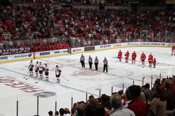 Hi-res-129037845-the-detroit-red-wings-and-the-ottawa-senators-stand-at_display_image