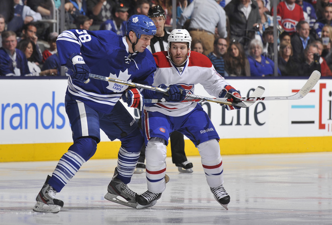 Hi-res-167848304-frazer-mclaren-of-the-toronto-maple-leafs-battles-with_crop_650x440