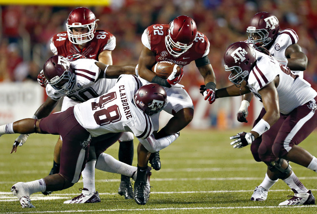 Hi-res-182258150-jonathan-williams-of-the-arkansas-razorbacks-is-tackled_crop_650x440