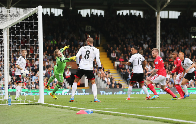 Hi-res-182104499-goalkeeper-david-stockdale-of-fulham-fails-to-stop-a_crop_650