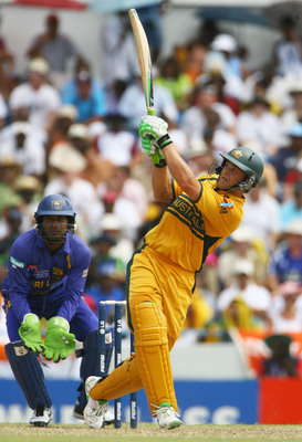 Hi-res-74016525-adam-gilchrist-of-australia-hits-out-watched-by-kumar_display_image