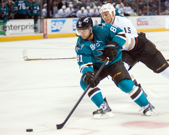 Sep 20, 2013; San Jose, CA, USA; San Jose Sharks center Tyler Kennedy (81) controls the puck against Anaheim Ducks center Ryan Getzlaf (15) during the second period at the SAP Center at San Jose. Mandatory Credit: Ed Szczepanski-USA TODAY Sports