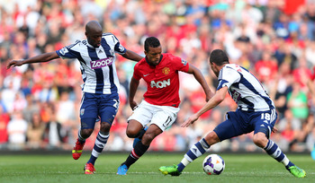 Hi-res-182115000-nani-of-manchester-united-takes-on-youssouf-mulumbu-and_display_image