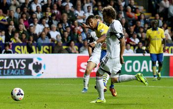 Hi-res-182123695-serge-gnabry-of-arsenal-scores-their-first-goal-during_display_image