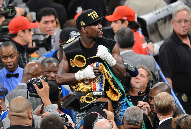 Hi-res-180623224-floyd-mayweather-jr-celebrates-his-majority-decision_crop_650x440