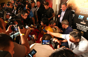 Hi-res-175801212-manny-pacquiao-meets-with-reporters-at-a-press_display_image