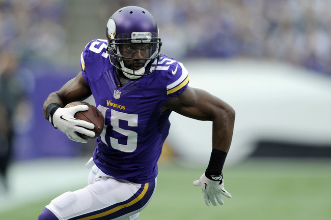 Hi-res-181693314-greg-jennings-of-the-minnesota-vikings-carries-the_crop_650